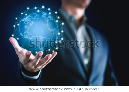 conceptual image of a big globe on hands  Stock photo © rufous