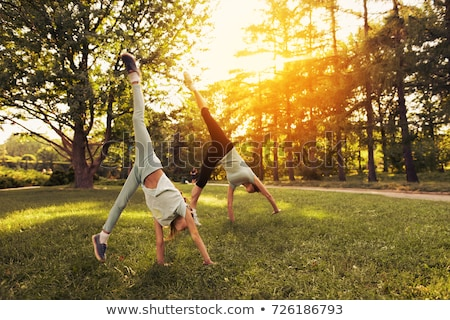 man doing handstand in park Stock photo © IS2