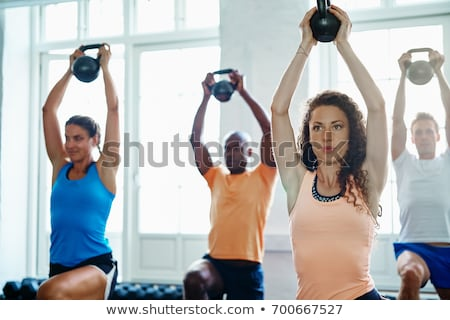 man raising kettle bell Stock photo © IS2