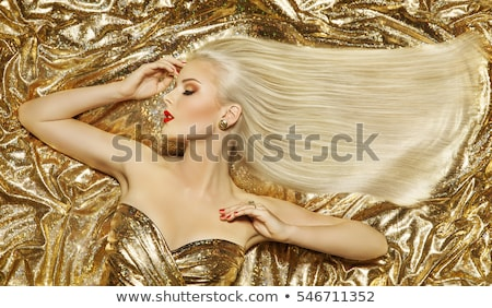 beautiful blond girl with sparkling makeup stock photo © svetography