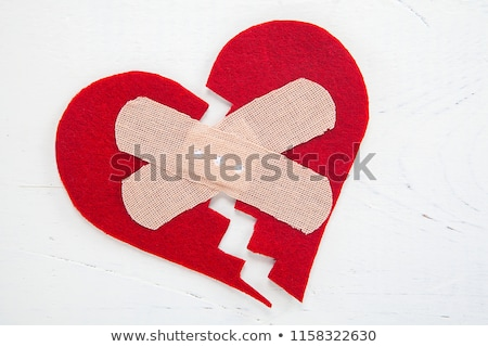 Red broken heart on white background Stock photo © wavebreak_media