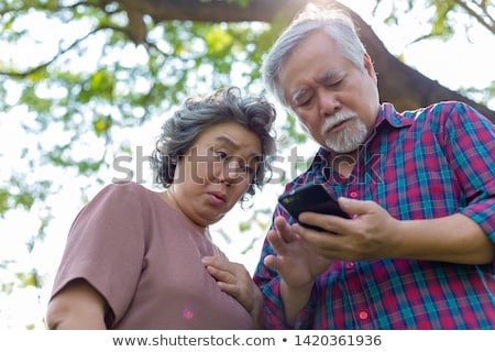 Idős nő ijedt fény kék portré Stock fotó © FreeProd