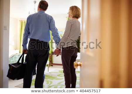 Senior Adult man standing in hotel room Stock photo © IS2