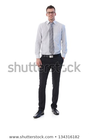 confident businessman with glasses standing with hand in pocket Stock photo © feedough