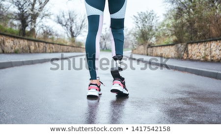 Cropped photo of athletic disabled invalid woman in tracksuit we Stock photo © deandrobot