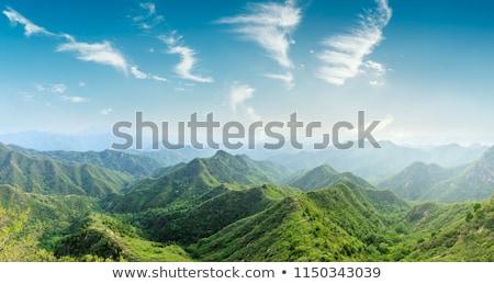 green mountain peak in white clouds stock photo © vapi