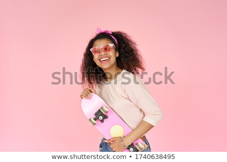 image of cheerful woman 20s wearing casual clothing holding blac stock photo © deandrobot