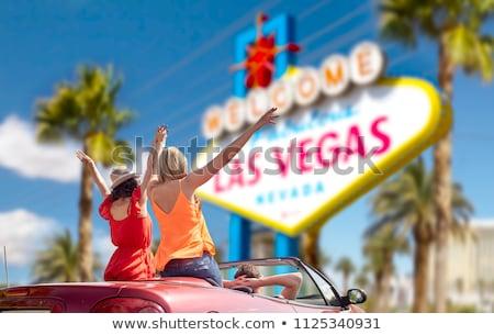 happy man driving convertible car at las vegas Stock photo © dolgachov