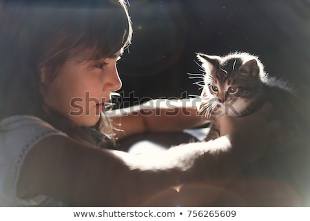 7 years old girl with kitten at home stock photo © lopolo