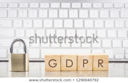 Close key with word LOCK on cubes, keyboard background. Stock photo © vinnstock