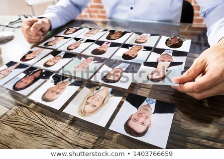 Businessperson Selecting Candidate's Photograph Stock photo © AndreyPopov