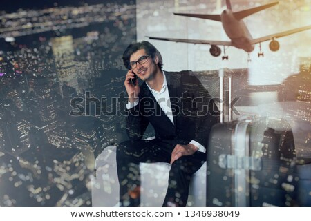Traveler businessman at the phone ready to fly. Double exposure Stock photo © alphaspirit