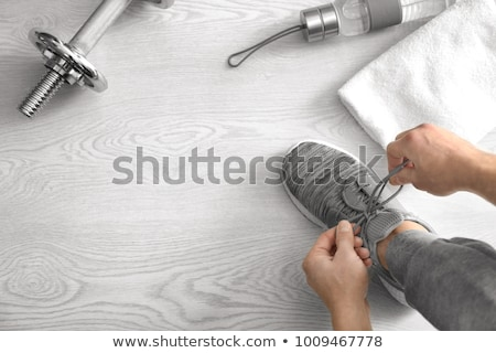 man tying shoe laces in gym stock photo © andreypopov