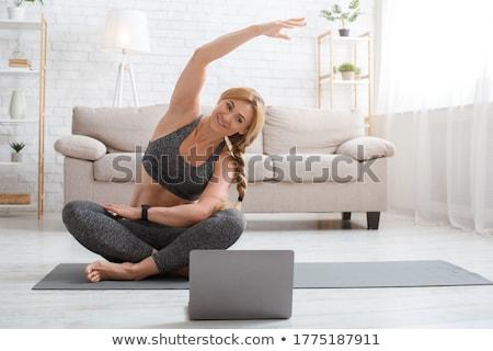 Pilates exercice femme de remise en forme étage femme Photo stock © Jasminko