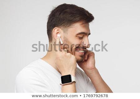 Guy with earphones Stock photo © pressmaster