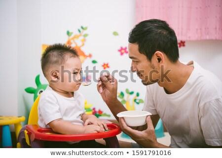 Jovem pai bebê filha cadeira casa Foto stock © Lopolo