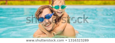 Dad and son in swimming Goggles have fun in the pool BANNER, LONG FORMAT Stock photo © galitskaya