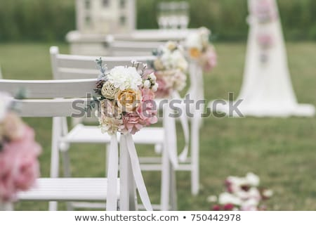 wedding arch and chairs on the green grass in the park.Wedding ceremony decoration Stock photo © ruslanshramko