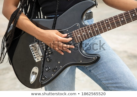 Hands of young musician of African ethnicity on strings of acoustic guitar Stock photo © pressmaster