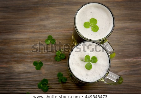 Stockfoto: Glasses Of Green Beer With Shamrock From Top