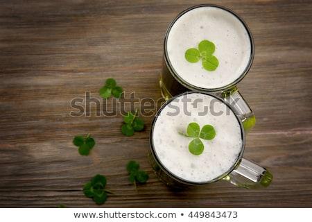 Szemüveg zöld sör shamrock felső Szent Patrik napja Stock fotó © dolgachov