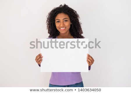 Joyful woman holding a white paper sign Stock photo © lichtmeister
