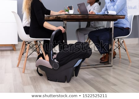 Baby In Carrier On Hardwood Floor At Office Stock photo © AndreyPopov