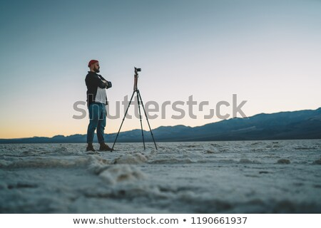 Man shoots at the camera on a tripod in the park Stock photo © galitskaya