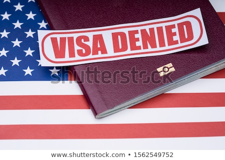 Visa Denied Text And Ukraine Passport Over American Flag Stock photo © AndreyPopov