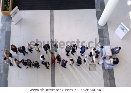 High angle view of multi-ethnic group business people standing in queue at office Stock photo © wavebreak_media