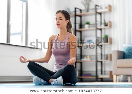 Vrouw mediteren lotus pose home geestelijkheid Stockfoto © dolgachov