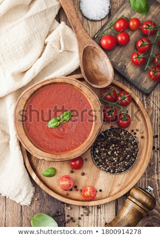 Foto stock: Wooden Plate Of Creamy Tomato Soup 0n Round Tray Pepper And Kitchen Cloth On Wooden Background With