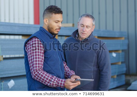 два строительство мужчин рабочих за пределами здании Сток-фото © Lopolo