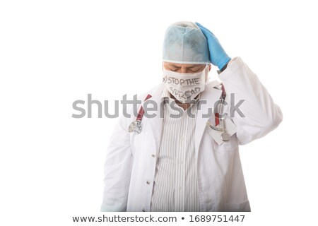 Anguished overworked doctor with head in hands during pandemic Stock photo © lovleah