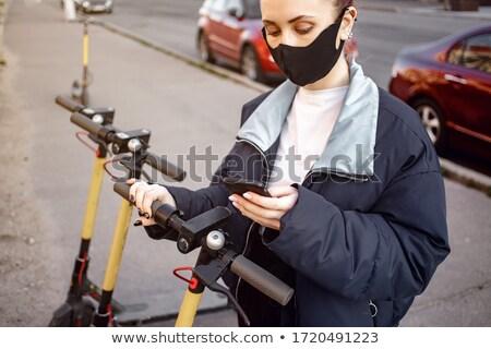 Teen girl is activating e-scooter Stock photo © dashapetrenko