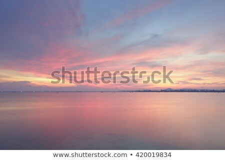 Tropical lagoon at sunset time. Long exposure shot. Stock photo © moses