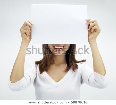 Concept Photo Of Asian Woman Holding A White Card Foto d'archivio © szefei
