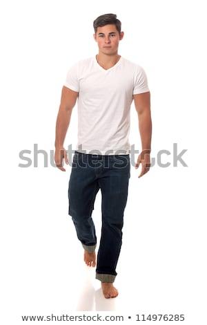 Сток-фото: Young Man Walking Studio Shot Over White