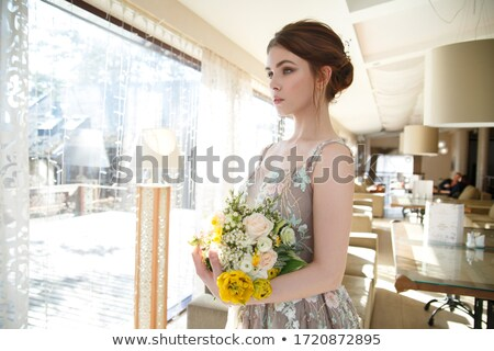 Stok fotoğraf: Bride And Her Bridesmaid In A Restaurant