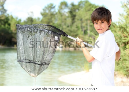 Young boy with a large fishing net Stock photo © photography33