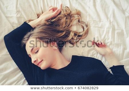 Assonnato nero cuscino bianco home Foto d'archivio © dolgachov