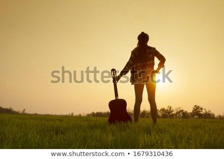 Lány akusztikus gitár fehér gitár modell fekete Stock fotó © RuslanOmega