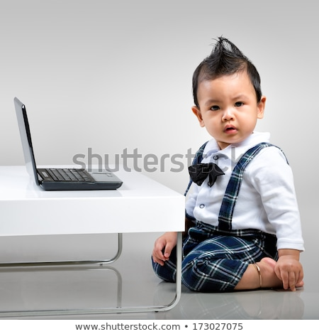 Сток-фото: Baby With Laptop Computer In Grey Background
