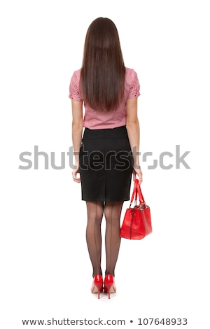 A slender girl with a satchel in the studio. View from the back Stock photo © RuslanOmega