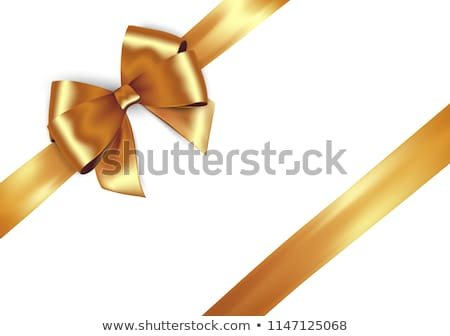 golden bow on a ribbon with white and red background stock photo © orson