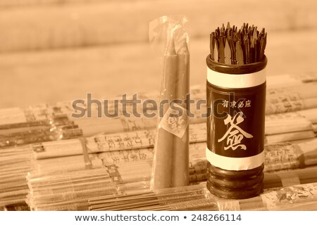 soothsaying, shake bamboo cylinder for fortune tell Stock photo © leungchopan