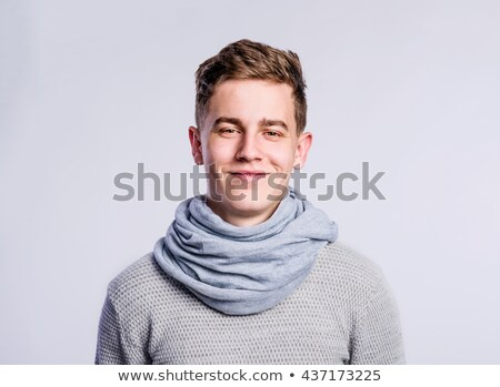 Fashionable young man with stylish haircut Stock photo © konradbak