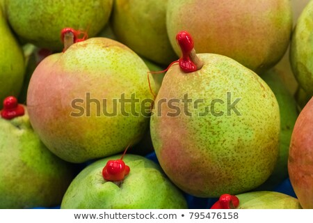 Green pear with red sealing wax Stock photo © AlessandroZocc