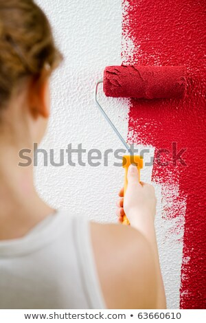 young woman painting a room red stock photo © photography33