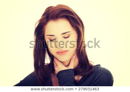 Encantador mulher jovem garganta dor retrato olhando Foto stock © pablocalvog